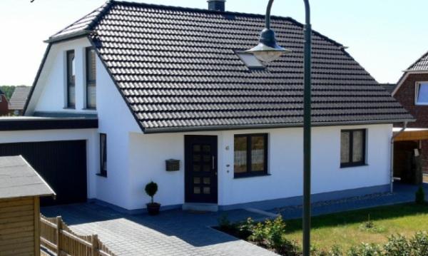 Конструкция дома с полувальмовой голандской крышей